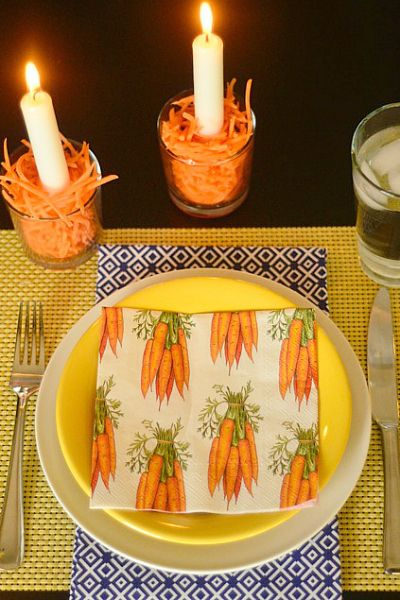 dettaglio tavola psqua-fiori-uova-cioccolato-non si dice piacere-buone maniere-carote-arancione