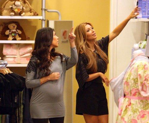 Slide-Photo-Kim-Kardashian-Pregnant-Kourtney-Kardashian-Shopping-Baby-Clothes